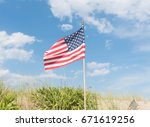 Small American Flag Waving In...