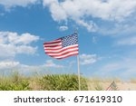 Tiny American Flag Waving In...
