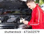 young handsome motor mechanic... | Shutterstock . vector #671632579