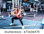 young woman in sportswear doing ...   Shutterstock . vector #671636470