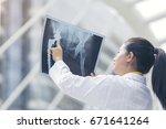smart woman doctor check hip... | Shutterstock . vector #671641264