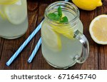 fresh organic lemonade with... | Shutterstock . vector #671645740