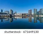 waterfront cityscape on sunny... | Shutterstock . vector #671649130