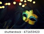 carnival mask | Shutterstock . vector #671653423
