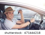 happy young man driver showing... | Shutterstock . vector #671666218