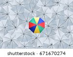 the multicolored umbrella over... | Shutterstock . vector #671670274