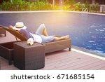 Man In Hat Sunbathing On Deck...