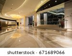 Stock photo hotel lobby interior with reception desk marble floor and crystal lamp 671689066