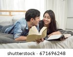 young loving couple reading... | Shutterstock . vector #671696248