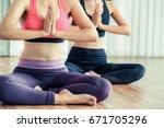 women practicing yoga pose in... | Shutterstock . vector #671705296