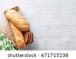 fresh bread on wooden table....   Shutterstock . vector #671715238