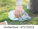 volunteer picking up litter... | Shutterstock . vector #671719213