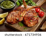 freshly grilled tomahawk steaks ... | Shutterstock . vector #671734936