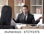 asian man interview woman for... | Shutterstock . vector #671741476