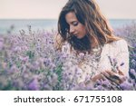 beautiful model walking in... | Shutterstock . vector #671755108