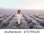 beautiful model walking in... | Shutterstock . vector #671755120