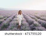 beautiful model walking in... | Shutterstock . vector #671755120