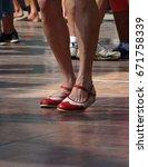 quickstepping feet of dancers... | Shutterstock . vector #671758339