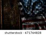 usa flag on a wood surface   Shutterstock . vector #671764828