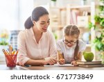 happy school time. mother and... | Shutterstock . vector #671773849
