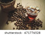 a glass of cold brewed coffee... | Shutterstock . vector #671776528