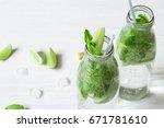 mojito cocktail in glass jars... | Shutterstock . vector #671781610