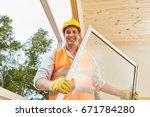 competent window fitter working ... | Shutterstock . vector #671784280