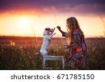 child with dog outdoor. girl... | Shutterstock . vector #671785150