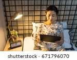 woman playing tablet computer... | Shutterstock . vector #671796070