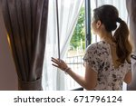 woman asian looking out the... | Shutterstock . vector #671796124