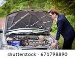 broken car with a businessman...   Shutterstock . vector #671798890
