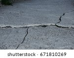 damaged asphalt road with... | Shutterstock . vector #671810269