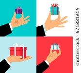 hand holding small gift box set....   Shutterstock .eps vector #671831659