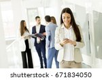 young business woman using a... | Shutterstock . vector #671834050