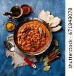 chicken tikka masala spicy... | Shutterstock . vector #671848078