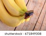 fresh banana set on brown... | Shutterstock . vector #671849308