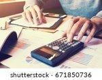 asian woman pressing calculator ... | Shutterstock . vector #671850736