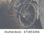 Small photo of old bilk wheel abandoned or old bicycle wreck vintage tone