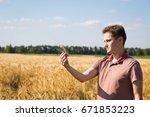 agronomist on barley  cereal... | Shutterstock . vector #671853223