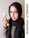 woman holding telephone with... | Shutterstock . vector #671856694