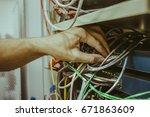 engineer man hand connects... | Shutterstock . vector #671863609