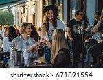 girls in a cafe   Shutterstock . vector #671891554