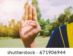 scout making an oath | Shutterstock . vector #671906944