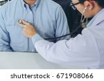 close up of doctor listening to ... | Shutterstock . vector #671908066