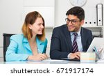 businessman and businesswoman... | Shutterstock . vector #671917174