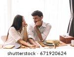 happy couple having breakfast...   Shutterstock . vector #671920624