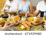 hands with white wine toasting... | Shutterstock . vector #671929480