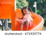cute asian child girl having... | Shutterstock . vector #671935774