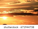 Small photo of Beautiful landscape with golden sunset and clouds afresh vividly