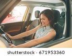 beautiful young woman buying a... | Shutterstock . vector #671953360